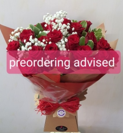Hand-tied red roses